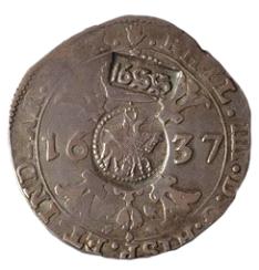 «Ефимок спризнаком» (надчеканки 1655года на брабантском талере 1637года).Источник: Википедия
